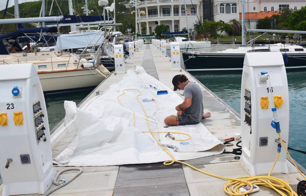 Patching up and cleaning the sails. And yes, we did almost lose the sail into the water more than once when a strong gust came through....!